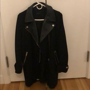 Perfect coat! Black with leather-like detailing.